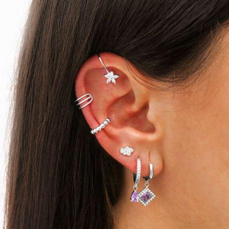 Piercing en las orejas de plata con piedras