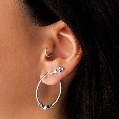 oreja piercing
